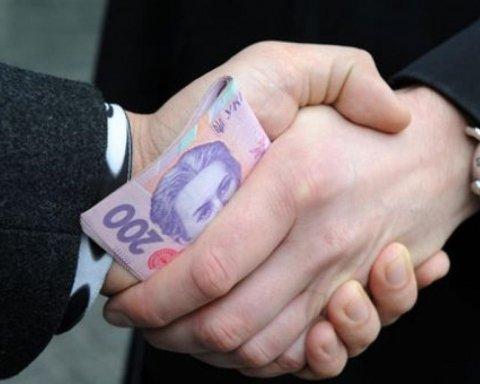 Нацполиция задержала депутата на получении крупной взятки